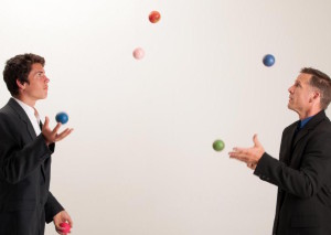 two-men-in-suits-juggling